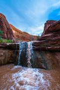 USA, Utah, Escalante Wilderness. Waterfall in Coyote Gulch - stock photo