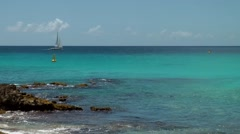 Stock Video Footage of Sint Maarten 091 Maho Beach one single sailing boat at horizon