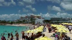Sint Maarten 095 Maho Beach landing of a learjet with beautiful cloud scenery Stock Footage