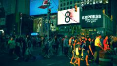 Crowded sunset New York City Times Square scenery, large group of people walking Stock Footage
