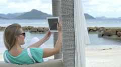 Woman taking selfie with tablet while enjoying vacation in tropical resort. Stock Footage