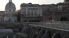 Distant shot of Santissimo Nome di Maria al Foro Traiano over bridge Stock Footage
