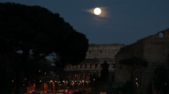 Amazing full moon over the Roman Colosseum Stock Footage