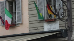 Stock Video Footage of Sign titled Piazza Del Popolo above an awning