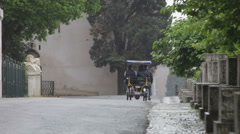Tourists take a ride in a Roman rickshaw on rainy day Stock Footage