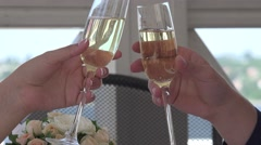 Couple toasting each other at restaurant with glasses of white wine, champagne Stock Footage