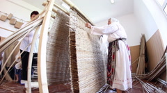 The art of weaving cattail mats - stock footage