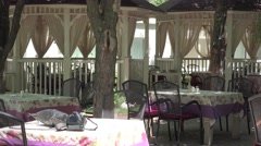 The interior courtyard of the restaurant on the river, swaying curtains, flowers Stock Footage