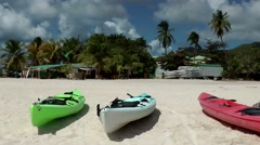 Sint Maarten 104 the beach in Simpson Bay colorful canoes in the sand Stock Footage