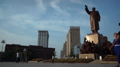 People walking under the statue of Mao zedong Stock Footage
