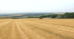 AERIAL 4K combine filling up a truck with crops, form a distance Stock Footage