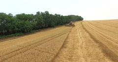 AERIAL 4K pan around a harvester Stock Footage