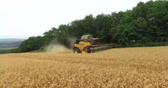 AERIAL 4K pan around a working combine Stock Footage