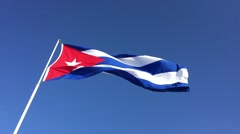 The flag of Cuba waving in the wind against a blue sky Stock Footage