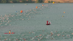 Swimmers in lake - Ironman European Championship in Frankfurt Germany in 2015 Stock Footage