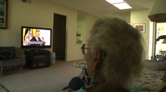 Old Senior Woman Sitting Couch Watching Obama On Television  Daily Life Retire - stock footage