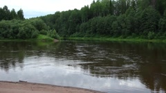 Landscape - the mouth of the river, fast current, forest shores Stock Footage