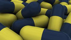 Stock Illustration of Pile of blue and yellow medication capsules.