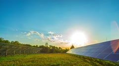 Solar panels and sun, panoramic time-lapse - stock footage