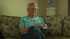 Old Senior Woman Sitting Couch Television Remote Control Daily Life Retirement - stock footage