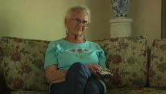 Old Senior Woman Sitting Couch Television Remote Control Daily Life Retirement Stock Footage