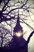 Vintage mysterious or scary church tower silhouette at sunset. Kuvituskuvat