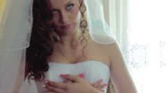 Beautiful young bride prepare for the wedding . - stock footage