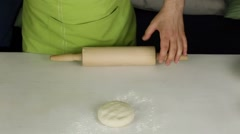 Rolling dough with a rolling pin Stock Footage