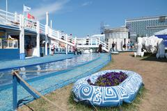 Stock Photo of PERM, RUSSIA - JUN 11, 2013: Decorative water channel and deck in festival to