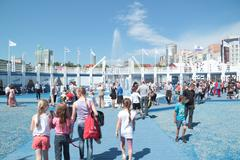 PERM, RUSSIA - JUN 11, 2013: Adults and children walking around festival town - stock photo