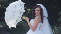 Bride on a Photo Shoot at The Park. Wedding day. Stock Footage