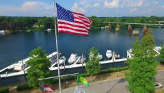 Aerial American flag over boat dock - stock footage