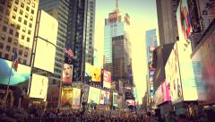 Yoga fans against the background of billboards and sky-scrapers in Times Square Stock Footage