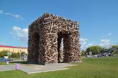 Stock Photo of PERM, RUSSIA - MAY 23, 2013: Russian big letter P made of logs - Perm city lo