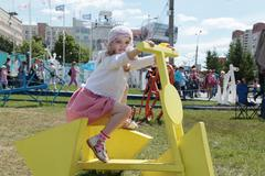 Stock Photo of PERM, RUSSIA - JUN 13, 2013: Girl on bike with triangular wheels in White Nig