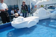PERM, RUSSIA - JUN 15, 2013: Children with large styrofoam ships in White Nig Stock Photos