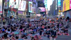 People take part in a mass yoga session in Times Square NYC - stock footage