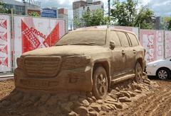 PERM - JUNE 10: Sand sculpture Toyota car at festival White Nights, on June 1 - stock photo