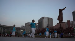 Chinese aunties dance under statue of Mao zedong Stock Footage