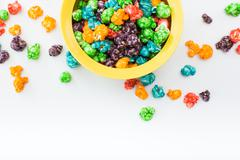 Brightly Colored Candied Popcorn, white background. Horizontal, junk food. Stock Photos