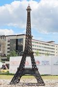 PERM, RUSSIA - JUNE 25, 2014: Parody of metal Eiffel Tower at festival White  - stock photo