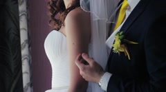 The Groom Kisses The Bride on The Shoulder. Stock Footage