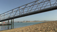 View of Hayling Island and Ferry Jetty across Langstone Harbour in Hampshire Stock Footage