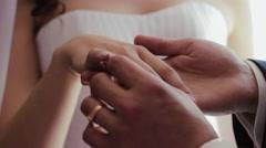Groom wear a Wedding Ring. - stock footage