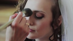 The Makeup Artist Does a Make-up to The Bride in the wedding day. - stock footage