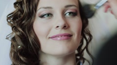 Stock Video Footage of The Makeup Artist Does a Make-up to The Bride. Preparations for the wedding .