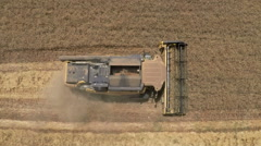 Aerial view of a combine harvester wheat field. Close up shot Stock Footage