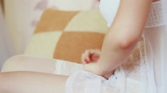 The bride dresses stockings . Preparations for the wedding . - stock footage