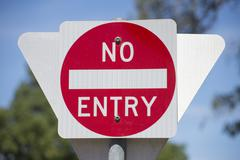 No entry road sign with blurred background outdoor Stock Photos