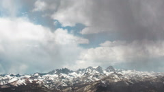 Time Lapse - Cloudscape Moving Over Snowy Mountains Stock Footage